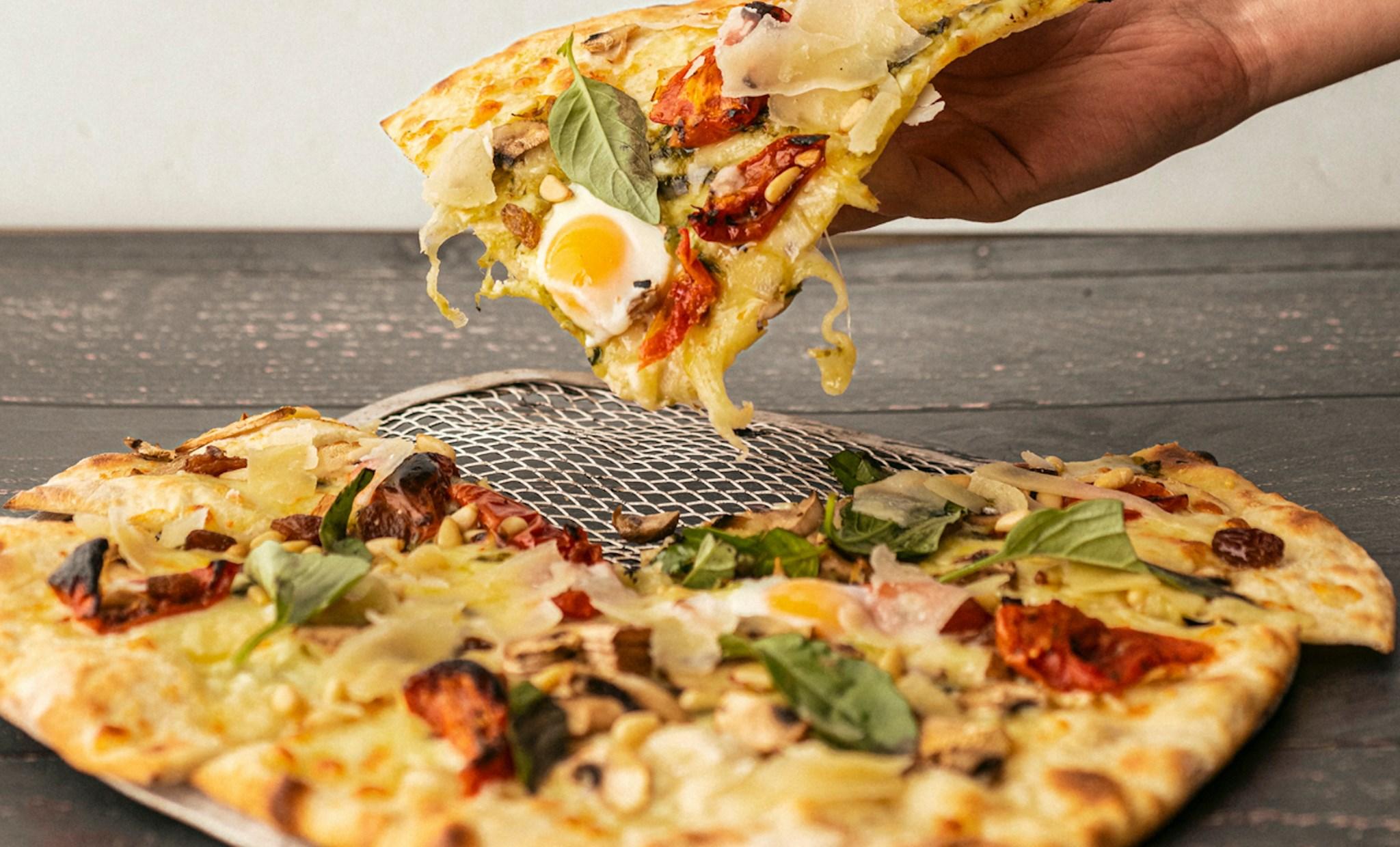 pizza para llevar - Platos para pedir a domicilio con los que siempre acertarás